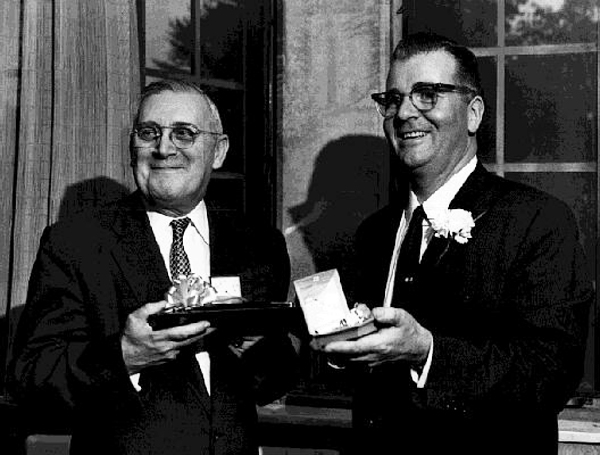 Arts and Sciences dean Andrew J. Townsend (left) presented gifts to President Asa S. Knowles at a party marking the departure of Dr. Knowles from UT in 1958