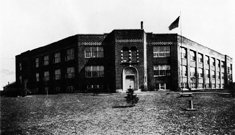 This building, partially constructed during World War I but never finished, was completed in 1922 as a classroom building for the University of Toledo. It was located on the Scott land at Nebraska Avenue. The university outgrew this building in less than